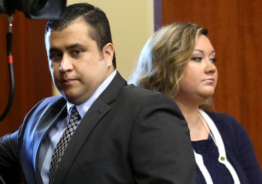 George Zimmerman, left, arrives in court in June with his wife, Shellie, in Sanford, Fla. Shellie Zimmerman called police on Monday, saying her husband had threatened her and her father.
