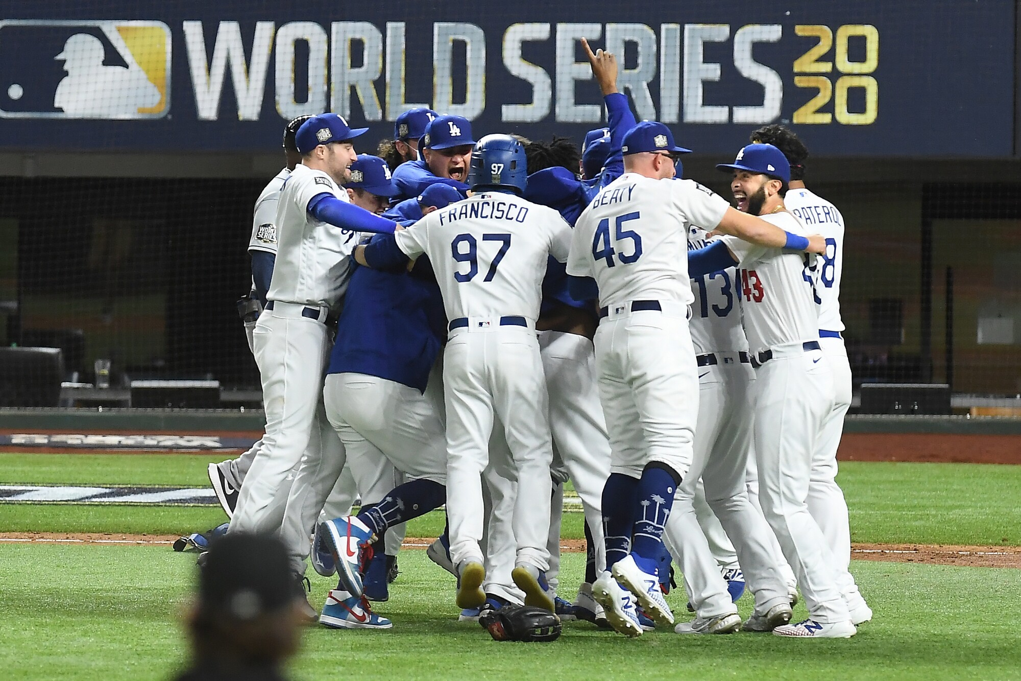 Dodgers players celebrate after defeating the Tampa Bay Rays in Game 6 of the World Series.