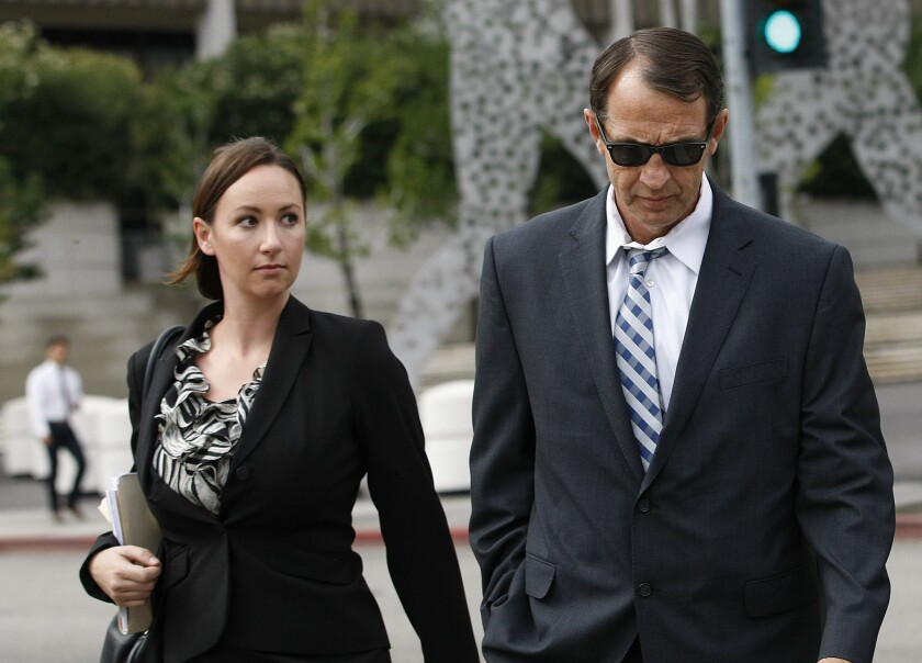 Retired L.A. County Sheriff's Capt. William Thomas Carey leaves the Roybal federal courthouse in Los Angeles after appearing for an arraignment on May 14.