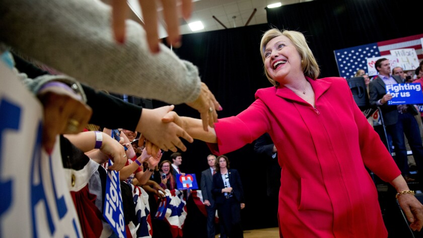 Democratic presidential candidate Hillary Clinton, center, arrives to speak at a get-out-the-vote event at Transylvania University in Lexington, Ky.