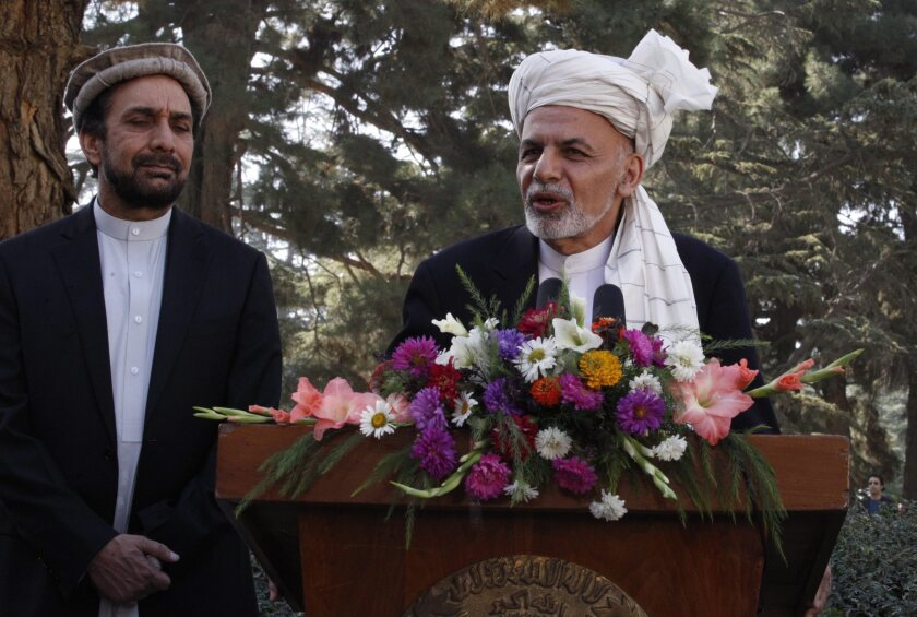 Afghan President Ashraf Ghani speaks to journalists on Eid al-Adha at the presidential palace in Kabul on Sept. 24, 2015.