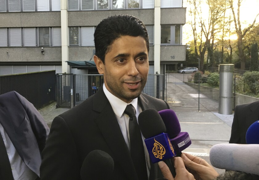 FILE - In this Wednesday Oct. 25, 2017 file photo, Paris Saint-Germain president Nasser Al-Khelaifi speaks to the media after a meeting today with Swiss prosecutors in Bern, Switzerland. Al-Khelaifi has been questioned again by Swiss federal prosecutors in a two-year investigation into allegations he bribed a FIFA official. The office of Switzerland's attorney general said on Monday, Dec. 2, 2019 al-Khelaifi, former FIFA secretary general Jerome Valcke and an unidentified businessman presented themselves for questioning in the Swiss capital. (AP Photo/Graham Dunbar, file)