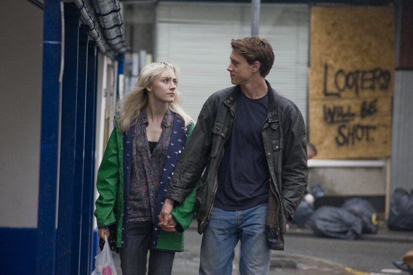 """This image released by Magnolia Pictures shows Saoirse Ronan, left, and George MacKay in a scene from """"How I Live Now."""" (AP Photo/Magnolia Pictures)"""