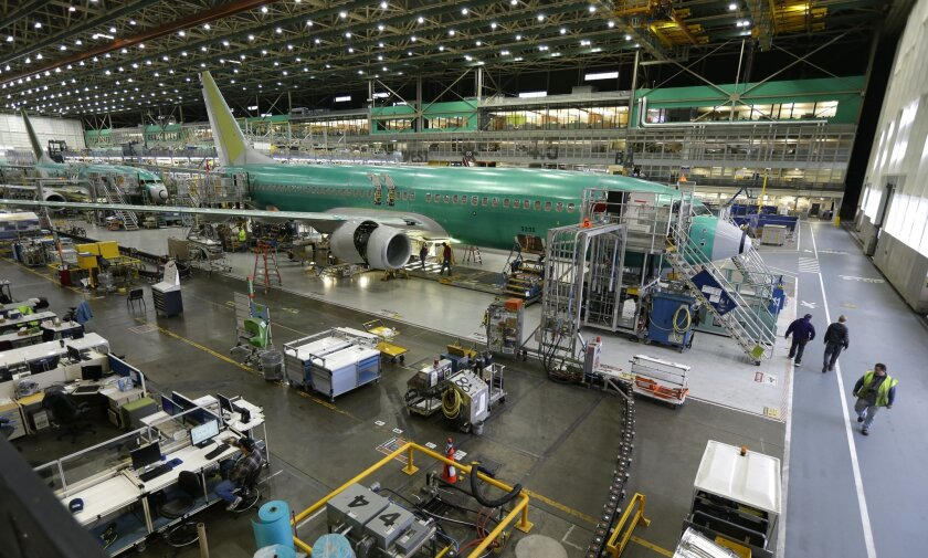 FILE - In this Dec. 16, 2014 file photo, Boeing 737-800 airplanes are on the assembly line at Boeing's 737 assembly facility in Renton, Wash. Orders to U.S. factories fell in September 2015 for a second straight month, the Commerce Department reported Tuesday, Nov. 3, 2015, with a key category that