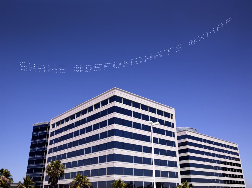 """SHAME #DEFUNDHATE,"" a message by Cassils over the Geo Group Headquarters, a private prisons firm, in L.A."