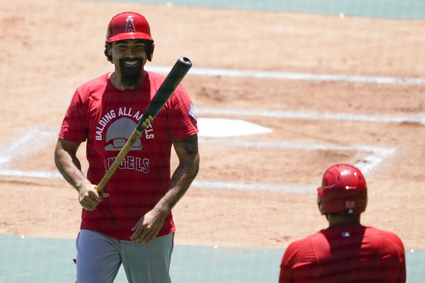 Los Angeles Angels' Anthony Rendon smiles after batting during practice at Angels Stadium on Friday, July 3, 2020, in Anaheim, Calif. (AP Photo/Ashley Landis)