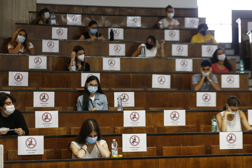 Students sit at a distance as a precaution against COVID-19, as they undergo an aptitude test to access the University of Medicine, in Rome Thursday, Sept. 3, 2020. (Cecilia Fabiano/LaPresse via AP)