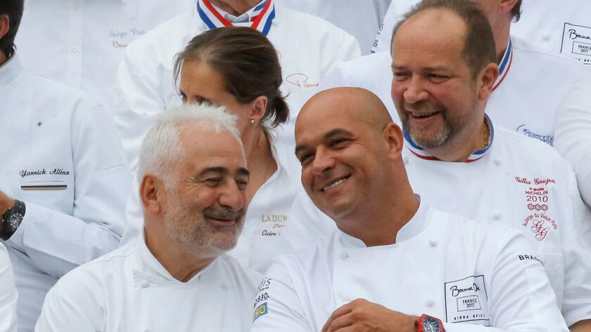 Chef Guy de Savoy talks to chef Jerome Bocuse the son of Paul Bocuse during an event at the Elysee P