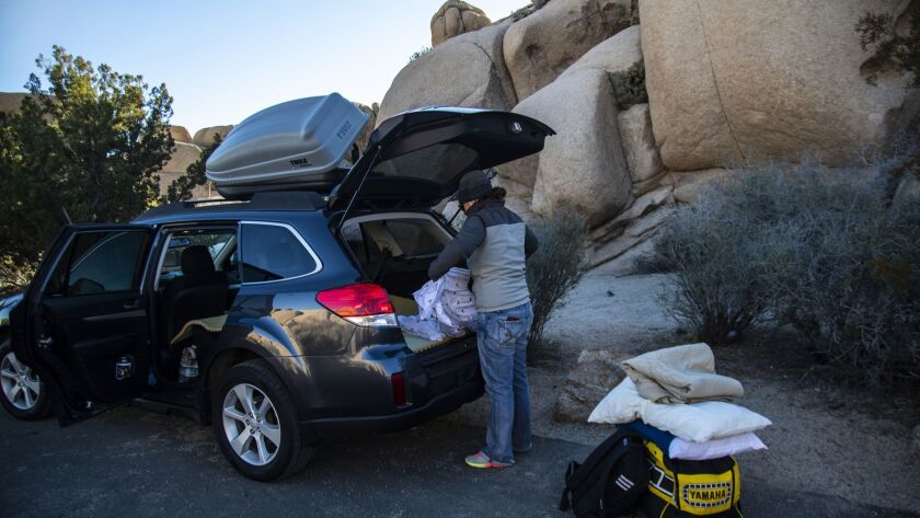 JOSHUA TREE, CA - JANUARY 2, 2019: Natalie Elsman of Iowa loads her car to move from her campground