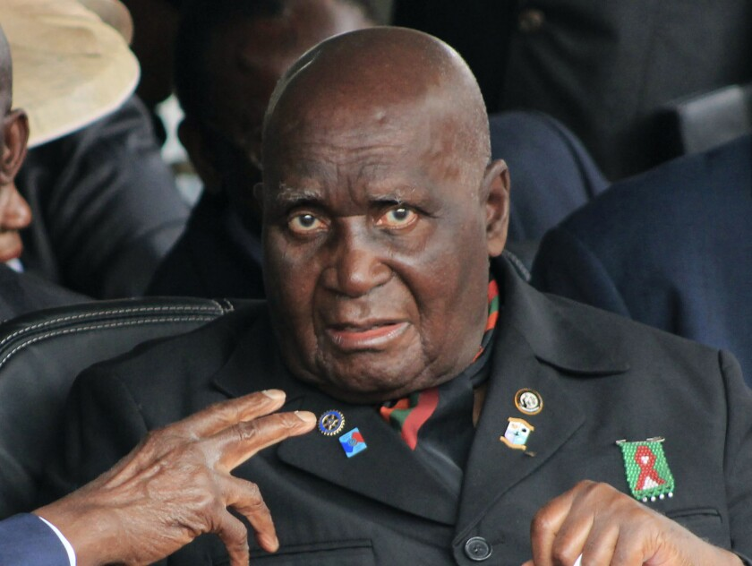 FILE - In this Jan. 25, 2015 file photo, former Zambian president, Kenneth Kaunda, attends the inauguration ceremony of the Patriotic Front's Edgar Lungu, in Lusaka. The country's first president, Kaunda, 97, has been admitted to hospital, his office announced Monday, June 14, 2021, as the southern African country battles a surge in COVID-19. (AP Photo/Moses Mwape, File)