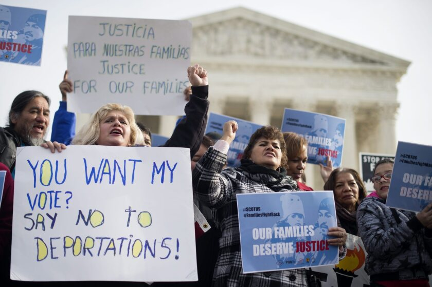 Immigration advocates rally outside Supreme Court