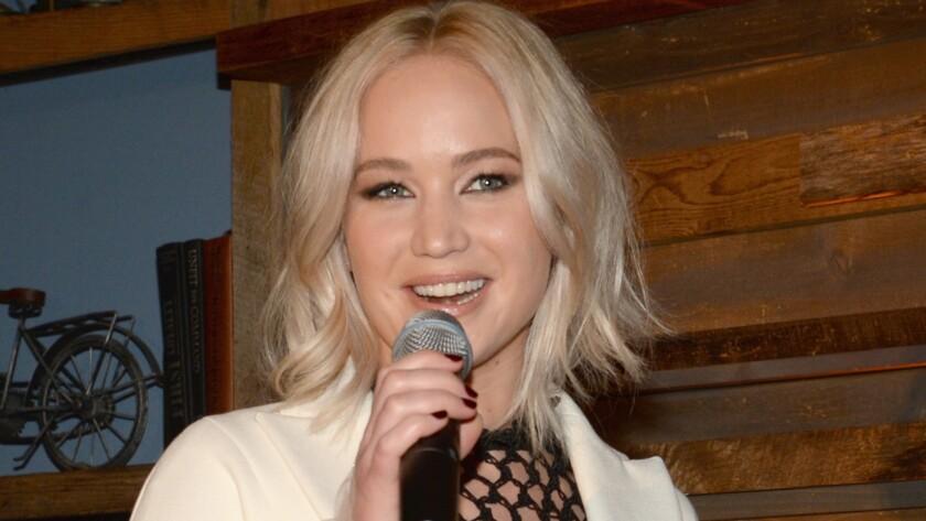 Jennifer Lawrence praises Patricia Arquette's activism at Women in Film pre-Oscar party