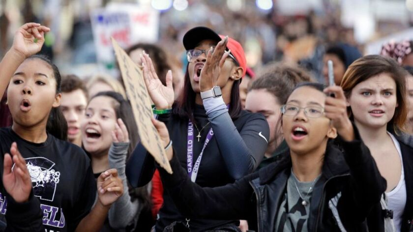 In this Nov. 14, 2016 file photo, students from Garfield High School march to rally with other students who walked out to protest the election of Donald Trump as president in Seattle.