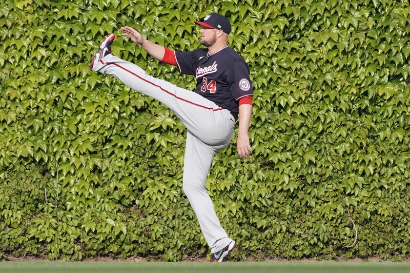 Washington Nationals starting pitcher Jon Lester stretches before a baseball game against the Chicago Cubs Monday, May, 17, 2021, in Chicago. (AP Photo/David Banks)