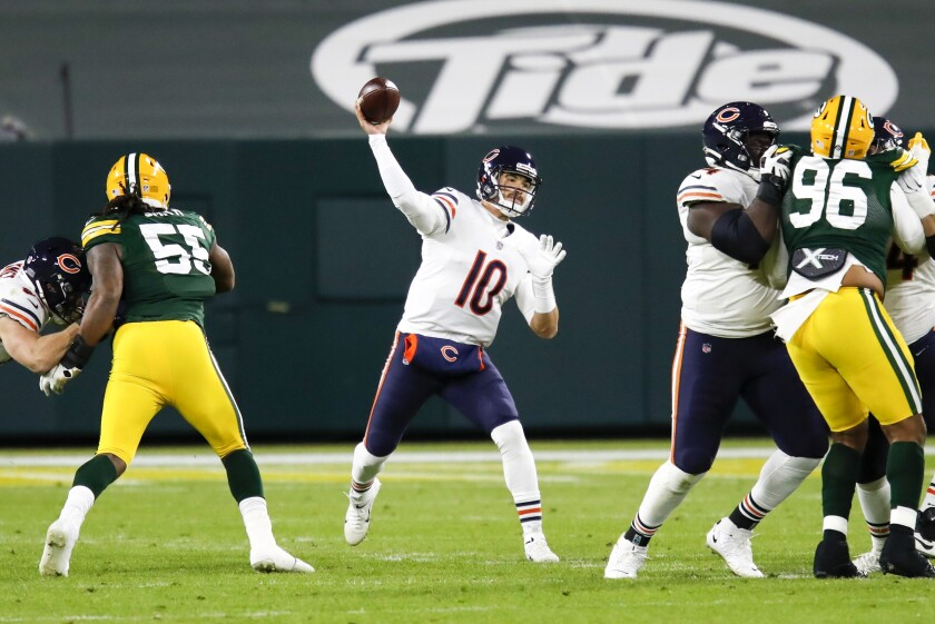 Chicago Bears' Mitchell Trubisky thorws during the first half of an NFL football game against the Green Bay Packers Sunday, Nov. 29, 2020, in Green Bay, Wis. (AP Photo/Matt Ludtke)