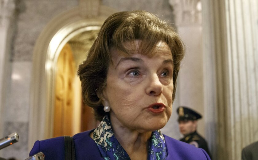 FILE - In this March 11, 2014, file photo, Senate Intelligence Committee Chair Sen. Dianne Feinstein, D-Calif. talks to reporters as she leaves the Senate chamber on Capitol Hill in Washington. Feinstein on Wednesday March 19, 2014, joined Gov. Jerry Brown in expressing skepticism about legalizing
