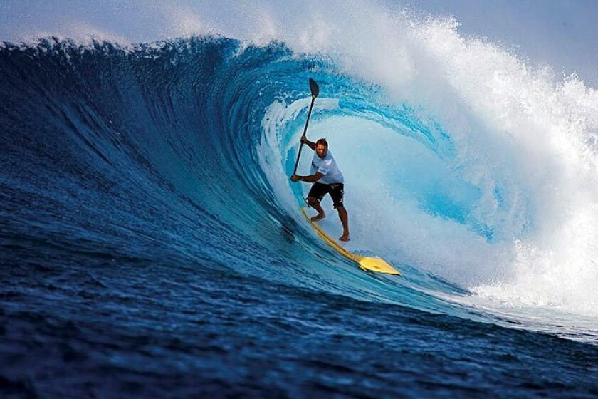 Iconic ocean sports figure Dave Kalama competes this Saturday in a four-mile paddleboard race off Oceanside Pier.