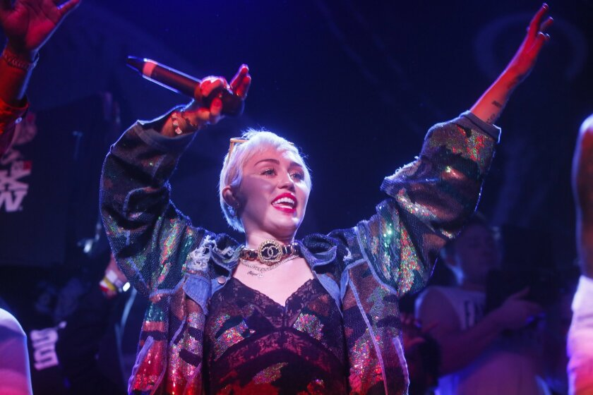 FILE - In this March 19, 2015 file photo, Miley Cyrus appears onstage for a Mike Will Made It performance at the Fader Fort Presented by Converse during the SXSW Music Festival in Austin, Texas. Cyrus is twerking back to the MTV Video Music Awards. Cyrus revealed on her social media accounts Monday, July 20, 2015, that she's hosting the Aug. 30 ceremony. (Photo by Jack Plunkett/Invision/AP, File)