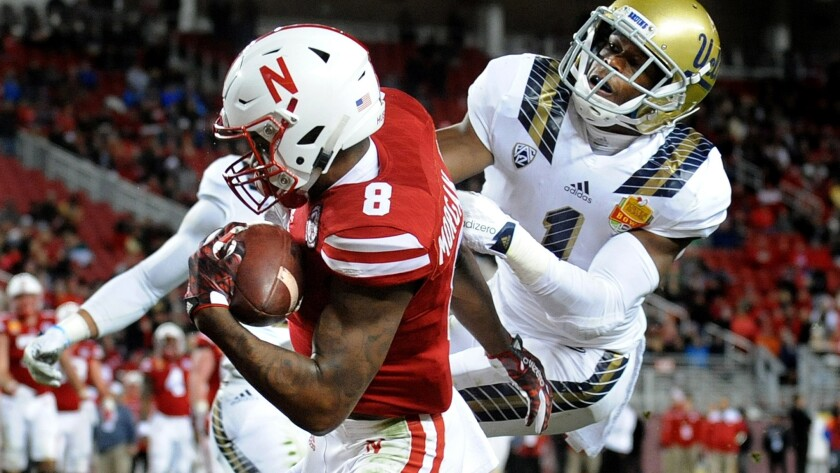 Nebraska receiver Stanley Morgan Jr. makes a one-handed catch for a touchdown against UCLA cornerback Ishmael Adams in the third quarter during the Foster Farms Bowl on Dec. 26.