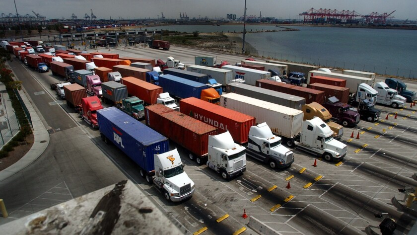 Truckers line up at the entrance of a cargo terminal in the Port of Long Beach.