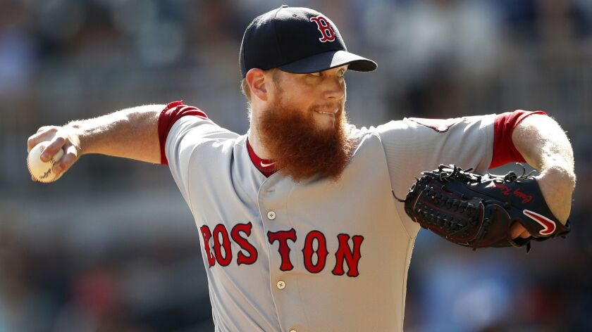Boston Red Sox relief pitcher Craig Kimbrel works against the Atlanta Braves in the ninth inning on Sept. 3, 2018, in Atlanta. The Chicago Cubs has added the closer to their bullpen on Wednesday.