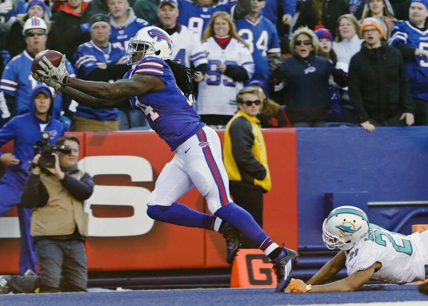 Buffalo Bills wide receiver Sammy Watkins (14) catches a pass for a touchdown in front of Miami Dolphins' Brent Grimes, right, during the second half of an NFL football game Sunday, Nov. 8, 2015, in Orchard Park, N.Y. (AP Photo/Bill Wippert)