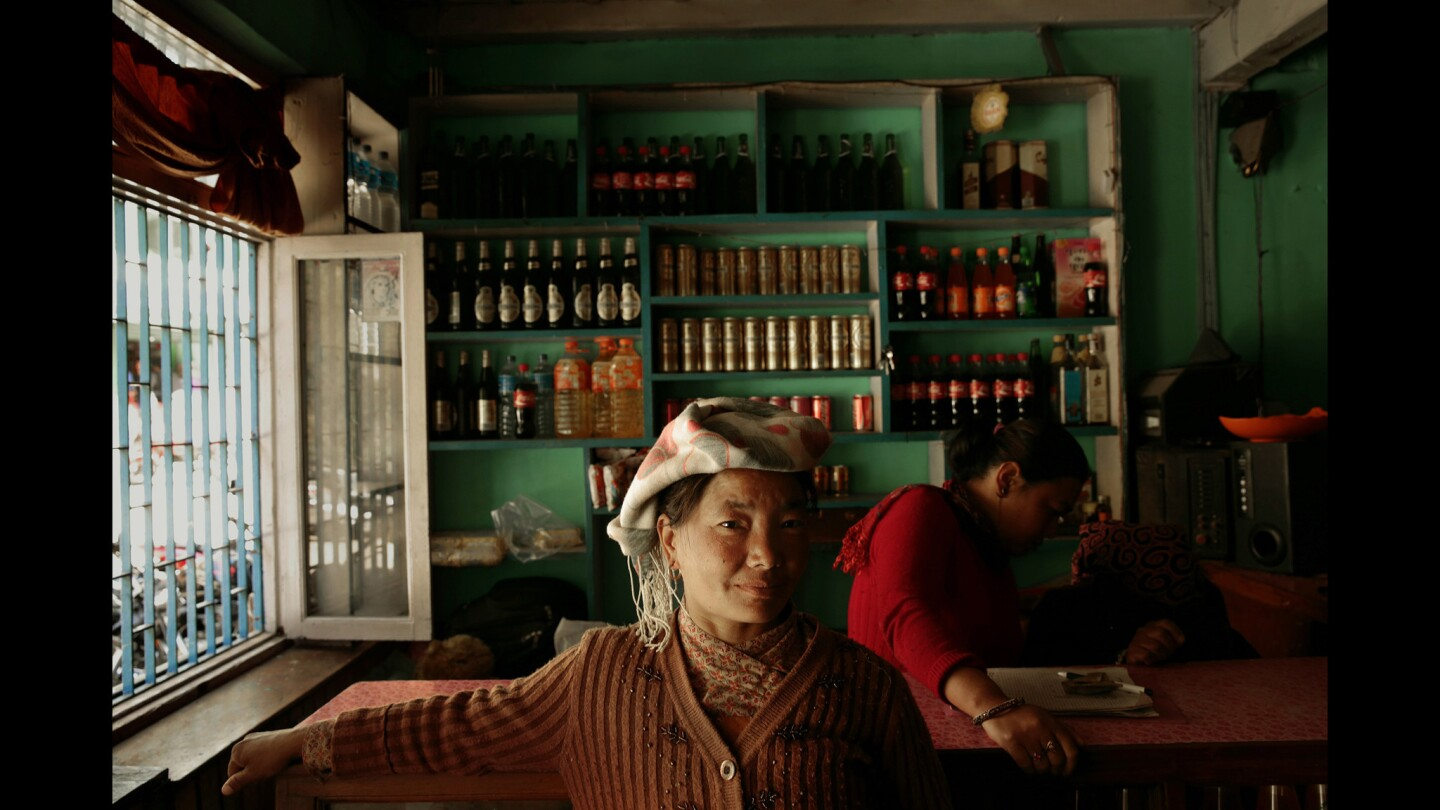 Two women work in a restaurant in Kodari, Nepal, a busy border town with China where many goods are coming into Nepal. China is pumping a lot of money into the economy. Two women work in a restaurant in Kodari.