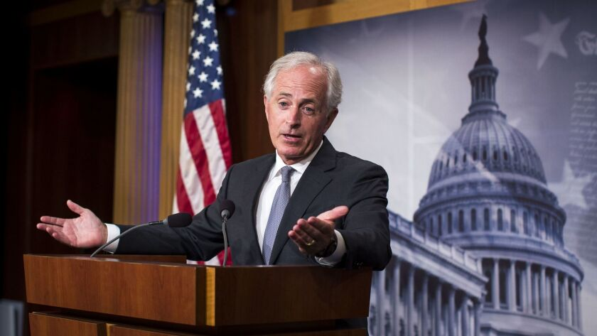 Sen. Bob Corker (R-Tenn.), responds to a question about whether he will seek re-election, on Capitol Hill in Washington.