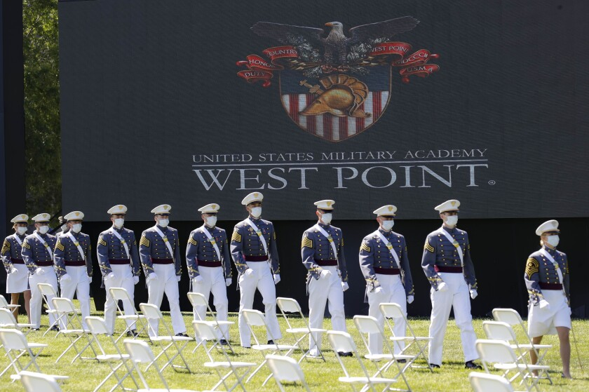 United States Military Academy graduating cadets march to their socially-distanced seating during commencement.
