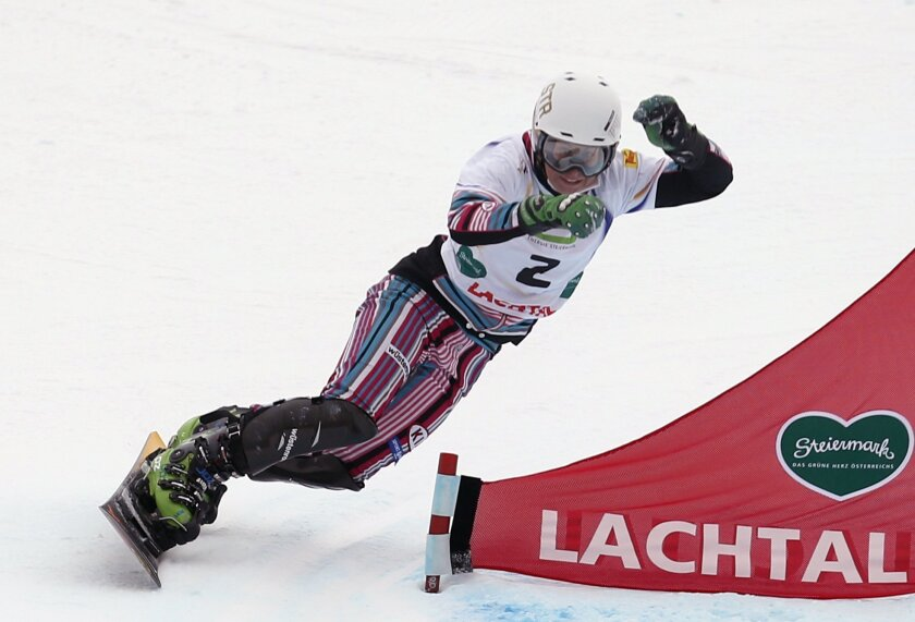 "FILE - In this Thursday, Jan. 22, 2015 file photo, Czech Republic's Ester Ledecka competes to win the women's parallel slalom event at the Freestyle Ski and Snowboard World Championships in Lachtal, Austria. Having won the parallel slalom at last year's snowboarding world championships, Ledecka made her Alpine skiing World Cup debut this month and has finished in the points (top 30) in four of her first five races in the challenging disciplines of downhill and super-G. That's an accomplishment that takes years of racing for many top athletes. ""Everybody thinks I'm crazy,"" Ledecka said after finishing 23rd in downhill on Saturday, Feb. 20 in La Thuile. ""I know. I am crazy. But I love the way it is and I love that all the girls here are really nice to me and welcome me."" (AP Photo/Darko Bandic, file)"