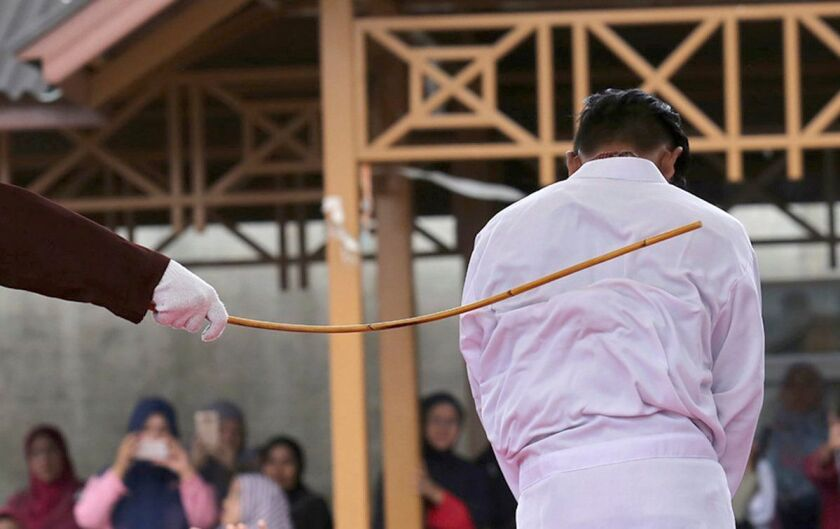 Two women in Malaysia received a caning, similar to this undated one involving an unidentified person, for engaging in a sexual relationship.