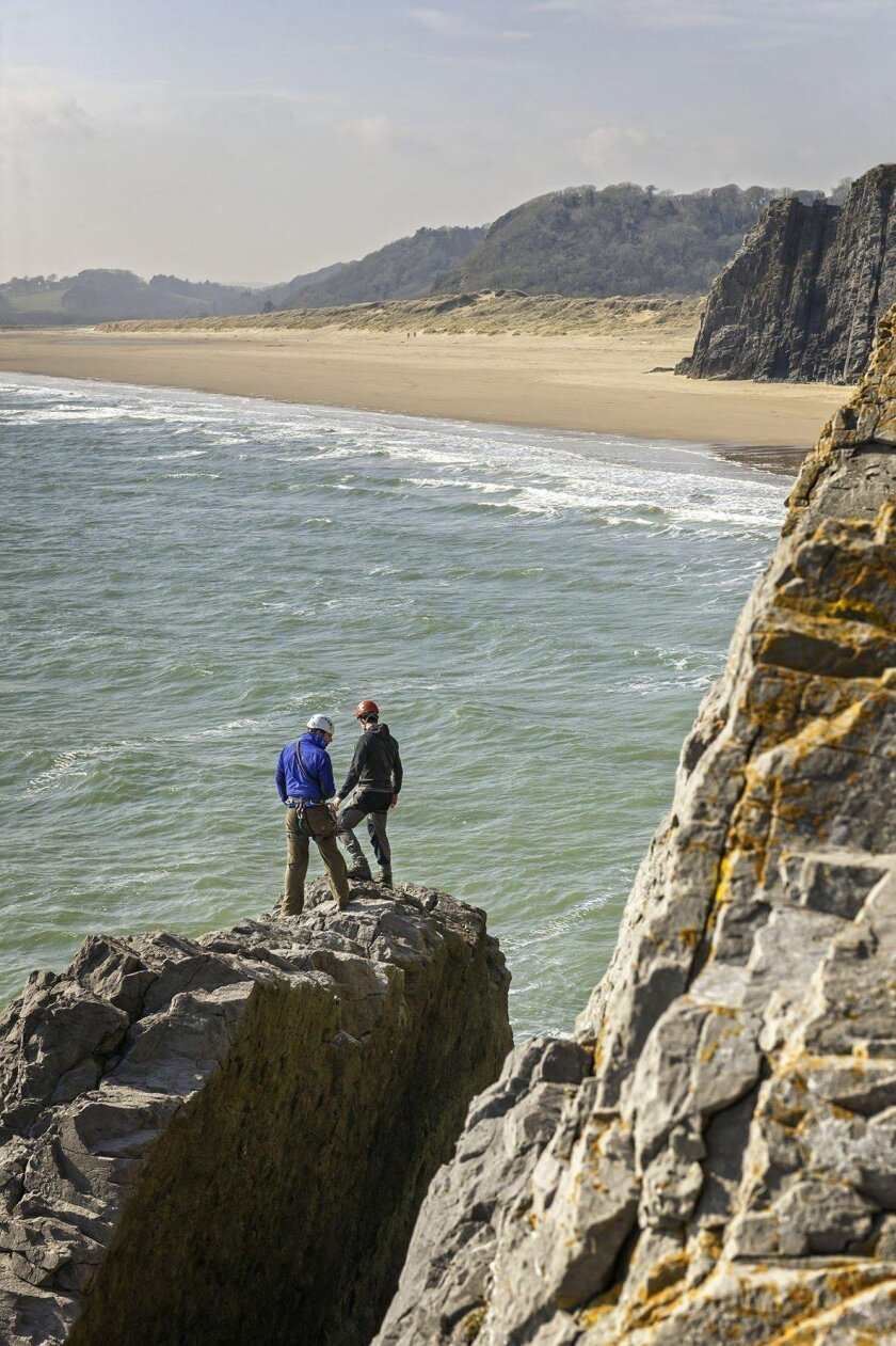 Sea level traversing at Great Tor, Tor Bay, near the hamlet of Penmaen on the Gower Peninsula, Swansea County, in Wales.