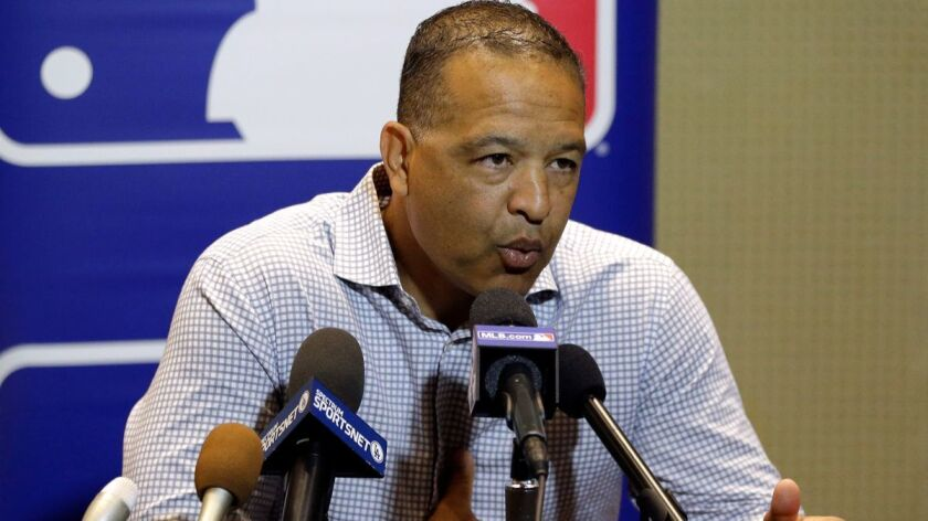 Dodgers manager Dave Roberts fields media questions Tuesday at the MLB baseball winter meetings in Orlando, Fla.