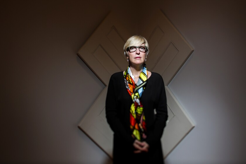 """Helen Molesworth, chief curator at the Museum of Contemporary Art in downtown Los Angeles, in front of Robert Gober's """"Untitled, 1998,"""" which is wood, steel and enamel, part of the museum's permanent collection."""
