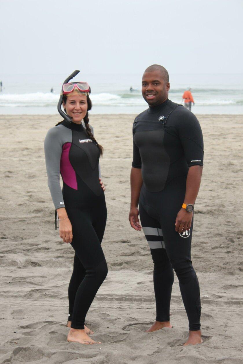 La Jolla Light reporter María José Durán and Birch Aquarium educational instructor Chris FitzSimmons prepare to go snorkeling at La Jolla Shores.