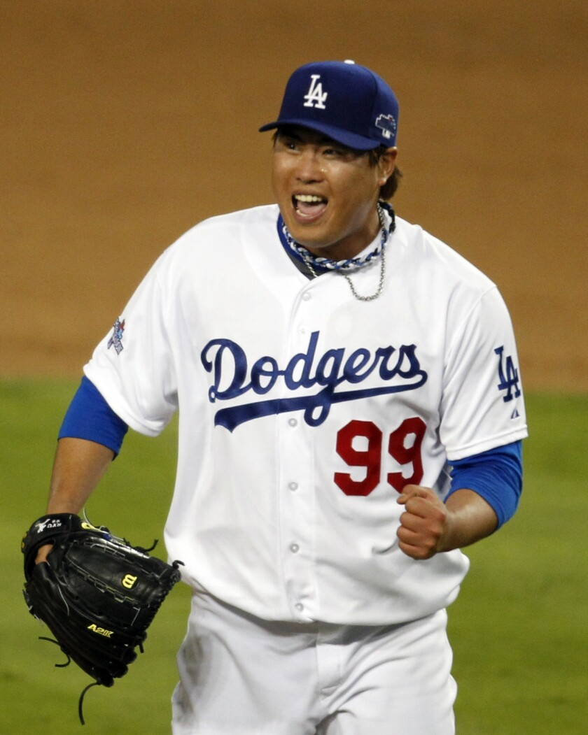 Dodgers starter Hyun-Jin Ryu celebrates his final strikeout during the seventh inning of the Dodgers' 3-0 victory over the St. Louis Cardinals in Game 3 of the National League Championship Series on Monday.