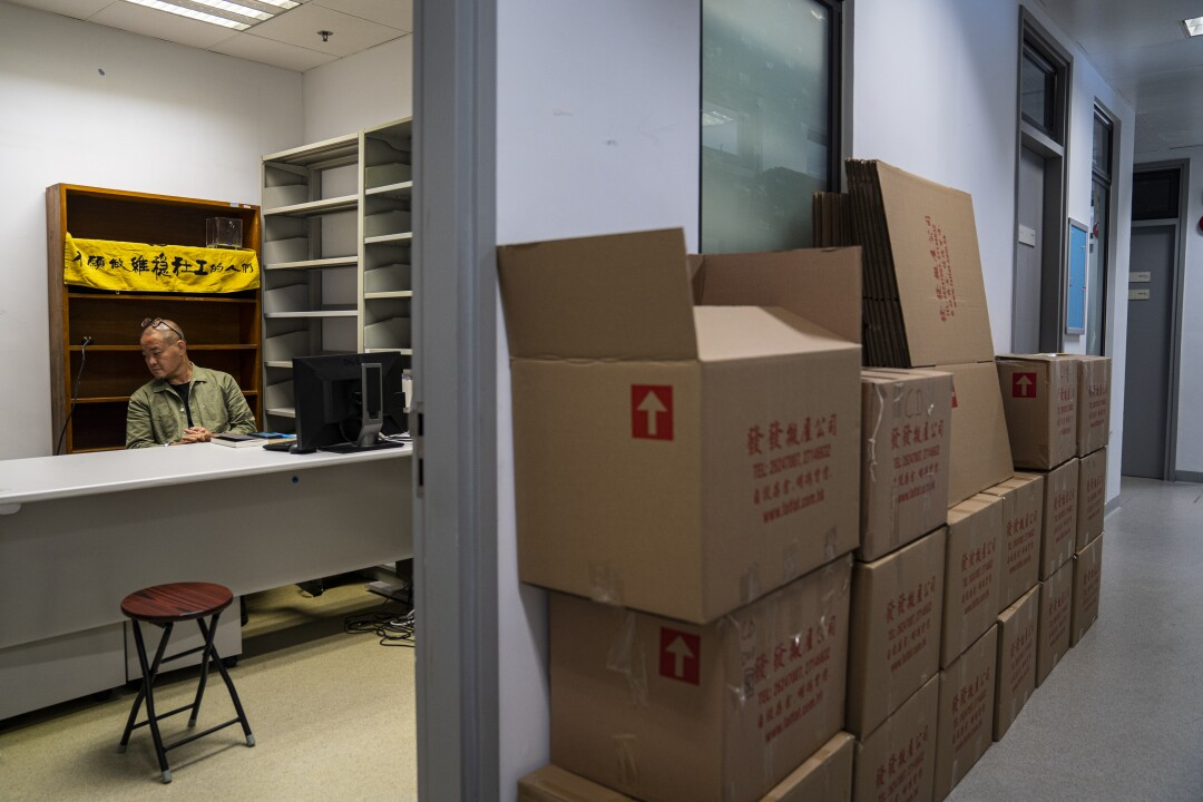 Hong Kong social work lecturer Shiu Ka-chun is waiting for the moving company in his vacated office.