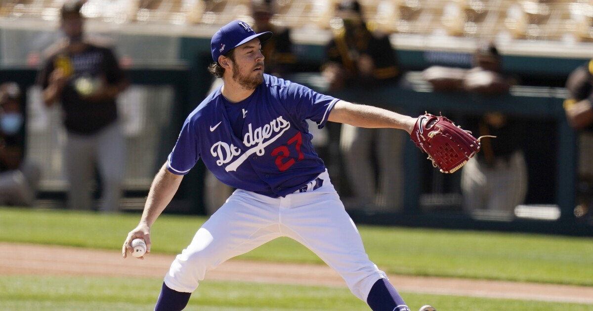 Dodgers' Trevor Bauer pitches with eye shut in spring loss - Los Angeles Times