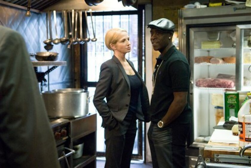 """In this film publicity image released by Overture Films, Ellen Barkin, left, and Don Cheadle are shown in a scene from, """"Brooklyn's Finest."""" (AP Photo/Overure Films, Phillip V. Caruso)"""