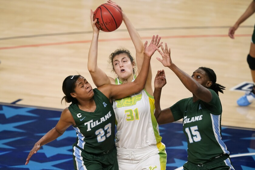 South Florida center Beatriz Jordao (31) grabs a rebound between Tulane forward Krystal Freeman, left, and forward Anijah Grant, right, during the second half of an NCAA college basketball game in the semifinal round of the American Athletic Conference women's tournament Wednesday, March 10, 2021, in Fort Worth, Texas. (AP Photo/Tony Gutierrez)