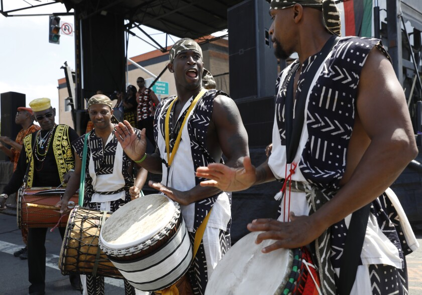 From left: Nana Yaw Songba, Uzoma Nelson, Nara Hall and Sean Jocely of Teyesa Thiosanne, an African dance and ensemble, perform as the Juneteeth celebration gets under way.