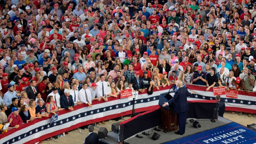 US President Donald Trump (C) addresses a 'Make America Great Again' rally in Harrisburg, PA, April