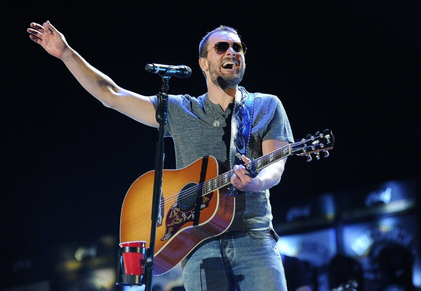 FILE - In this April 25, 2014 file photo, Eric Church performs during his headlining set on day one of the 2014 Stagecoach Music Festival at the Empire Polo Field in Indio, Calif.  Church, who has five nominations for the 2015 CMA Awards on Wednesday, Nov. 4, 2015, is nominated for the top prize, e