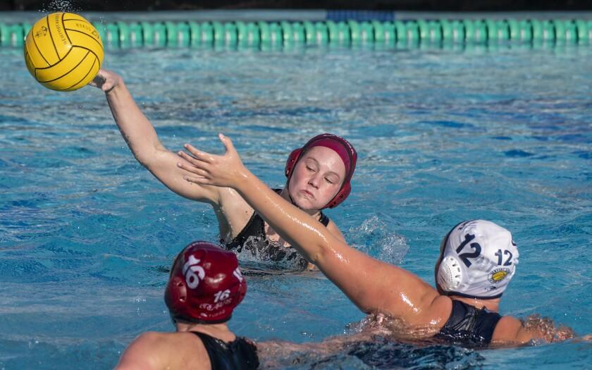 Laguna Beach's Rachael Carver takes a shot against Newport Harbor's Olivia Giolas during the Holiday