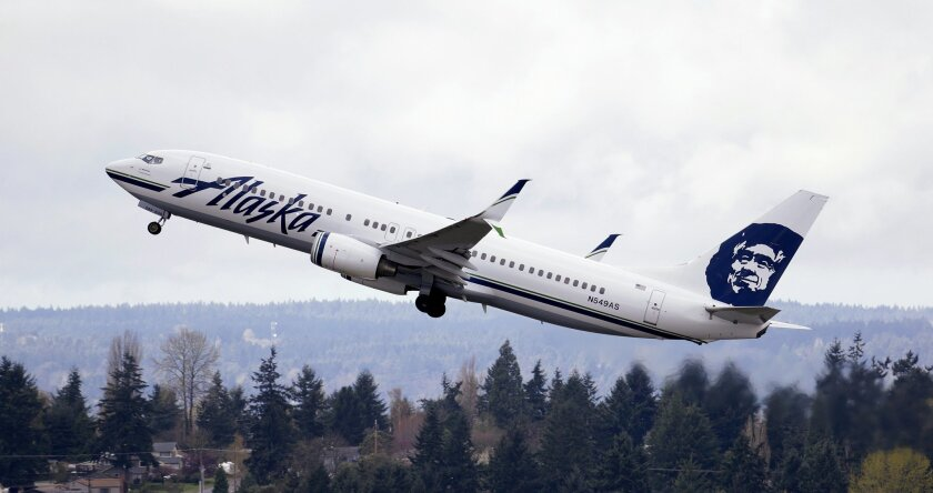 In this photo taken March 24, 2015, an Alaska Airlines jet takes off at Seattle-Tacoma International Airport in SeaTac, Wash. A U.N. panel on Feb. 8, 2016, proposed long-sought greenhouse gas emissions standards for airliners and cargo planes beginning in 2020 for new aircraft designs and three yea