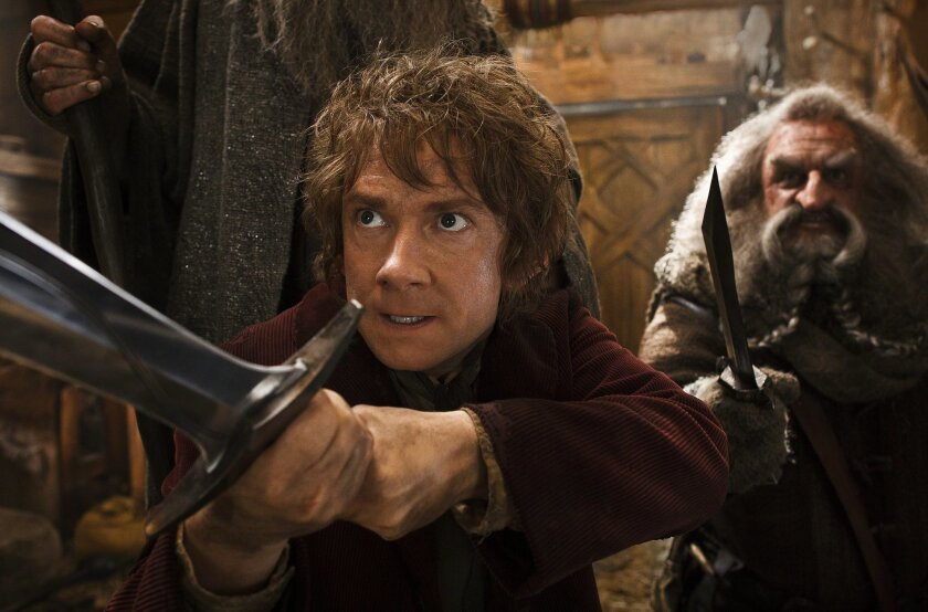 """This image released by Warner Bros. Pictures shows Martin Freeman, left, and John Callen in a scene from """"The Hobbit: The Desolation of Smaug."""" (AP Photo/Warner Bros. Pictures, Mark Pokorny)"""