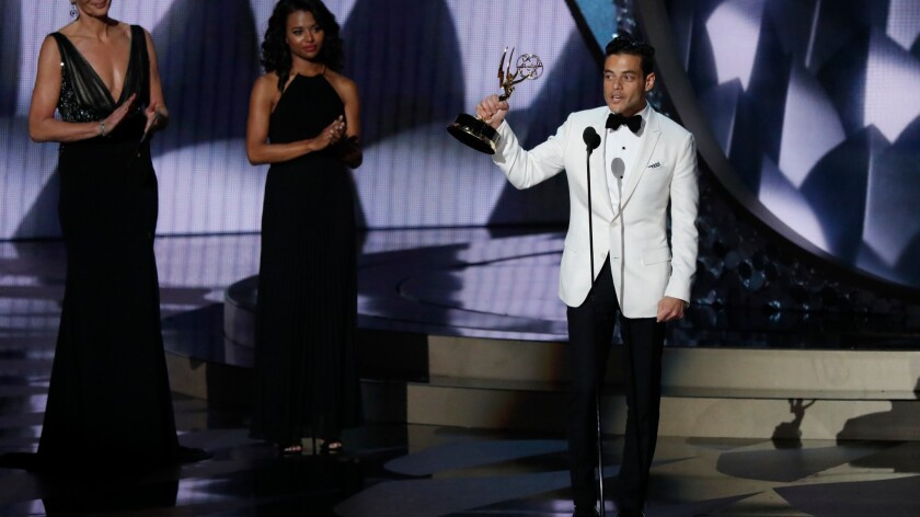 Rami Malek speaks as he accepts his Emmy for lead actor in a drama series.