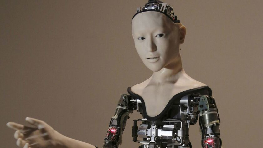 """FILE - This Monday, Aug. 1, 2016 file photo shows the humanoid robot """"Alter"""" on display at the Natio"""