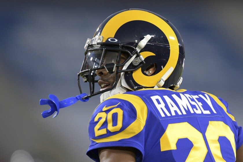FILE - In this Dec. 8, 2019, file photo, Los Angeles Rams cornerback Jalen Ramsey watches during an NFL football game against the Seattle Seahawks in Los Angeles. Ramsey remains confident he will sign a new contract with the Rams as he heads into the final season of his rookie deal. (AP Photo/Kyusung Gong, File)