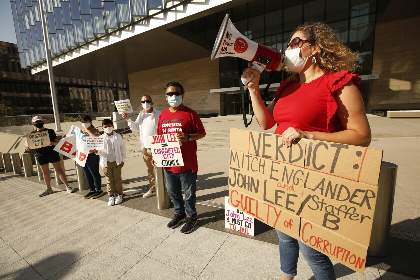 Pilar Schiavo of West Valley People's Alliance and others protest outside the federal court in Los Angeles.